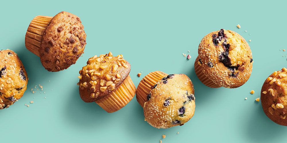 various muffins arranged on an aqua background
