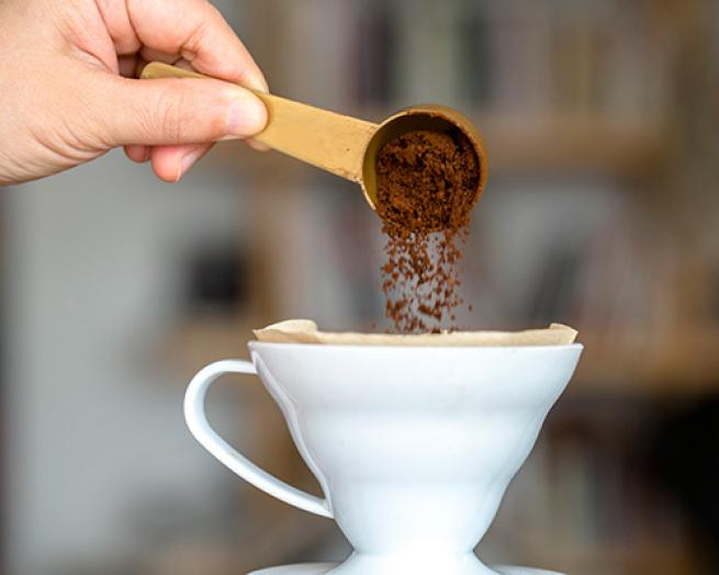 a close up of a person holding a cup of coffee