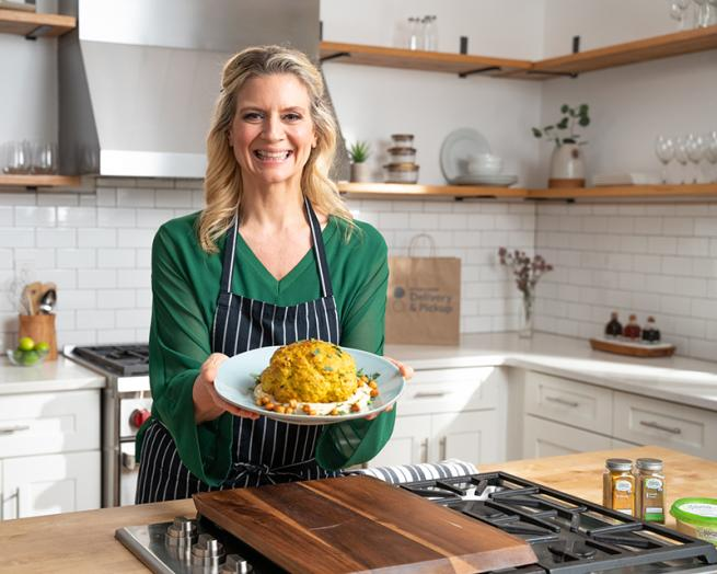 Amanda Freitag cooking food in a kitchen