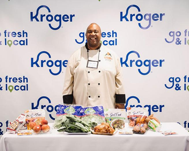 a person standing in front of a plate of food