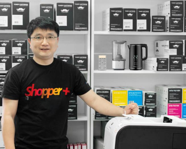 a person standing with products